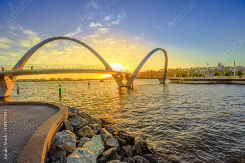 Foto op Canvas Oceanië Scenic and iconic Elizabeth Quay Bridge at sunset light on Swan River at entrance of Elizabeth Quay marina. The arched pedestrian bridge is a new tourist attraction in Perth, Western Australia.