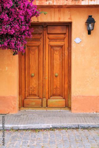 Fotografie, Obraz  Wooden door of a house in historic quarter of Colonia del Sacramento, Uruguay