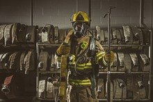 Firemen Wearing His Respiratory Mask And Protection Gear