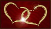 Two Golden Hearts On Red Velvet