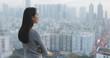 Leinwandbild Motiv Confident woman looking at the city