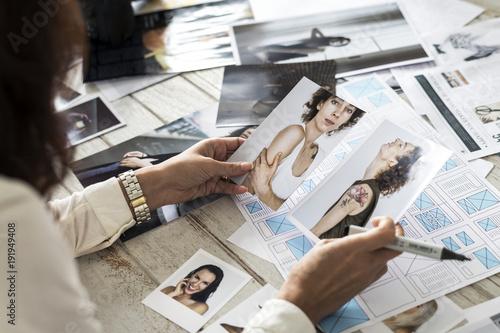 Photo  Magazine editor selecting models