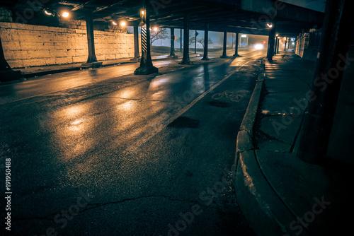 Fototapety, obrazy: Dark city alley industrial train bridge underpass at night.