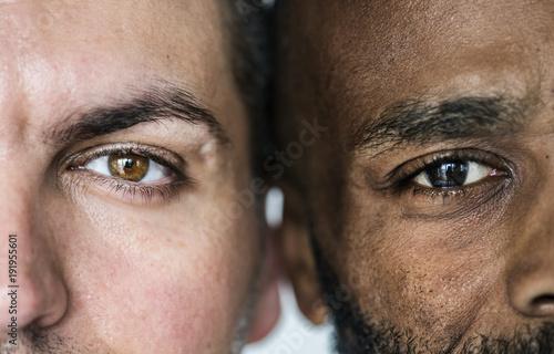 Fotografiet  Two different ethnic men's eyes closeup