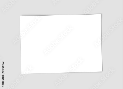 Valokuva  White empty paper sheet with realistic shadow isolated on gray background
