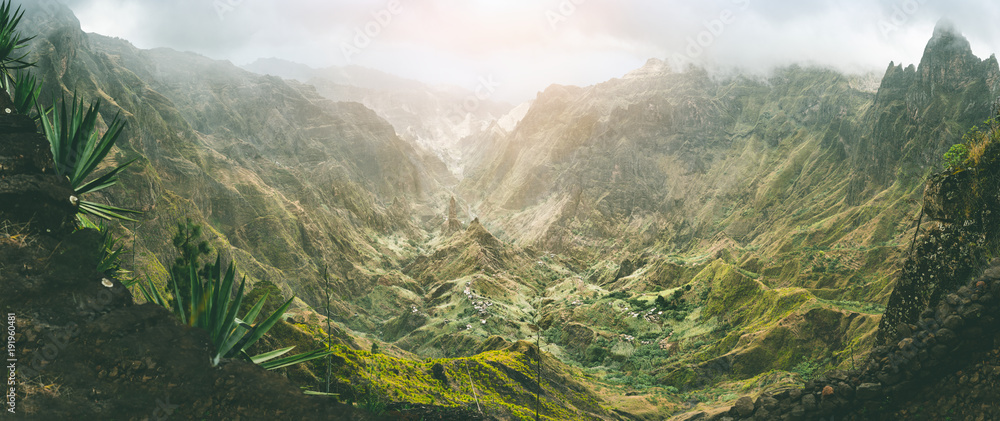Fototapety, obrazy: Xo-Xo valley with harsh peaks surrounded by mountains. Slopes are covered by agave plants. Small local village located in the valley. Santo Antao island, Cape Verde. Panoramic shot