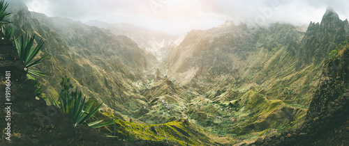Foto auf Leinwand Gebirge Xo-Xo valley with harsh peaks surrounded by mountains. Slopes are covered by agave plants. Small local village located in the valley. Santo Antao island, Cape Verde. Panoramic shot