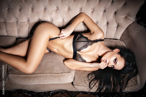 Strange Sexy Woman In Seductive Black Lingerie Lying On A Couch Uwap Interior Chair Design Uwaporg