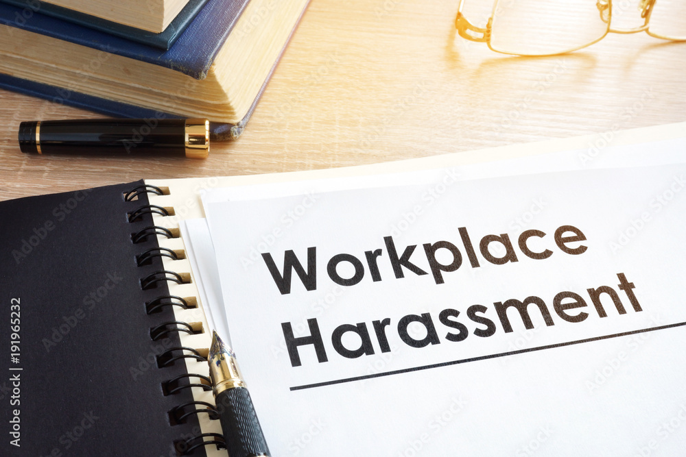 Fototapeta Documents about workplace harassment in an office.