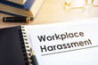 canvas print picture - Documents about workplace harassment in an office.