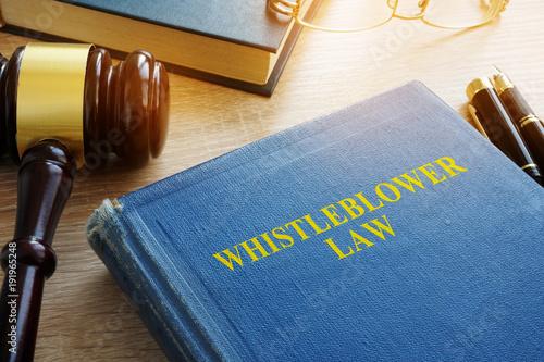 Whistleblower law on a court desk. Canvas Print