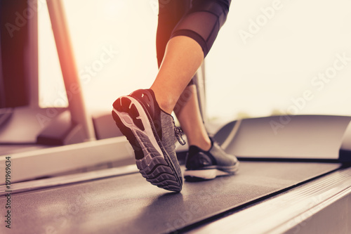 Obraz na płótnie Exercise treadmill cardio running workout at fitness gym of woman taking weight loss with machine aerobic for slim and firm healthy in the morning