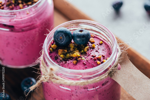 Fototapeta close-up view of sweet healthy smoothie with granola, nuts and berries obraz