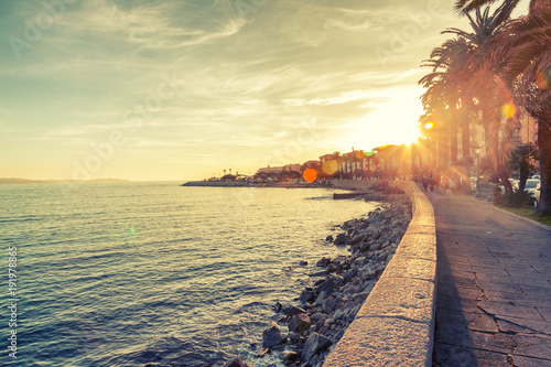 Fototapeten See sonnenuntergang Beautiful cityscape, the promenade in Ajaccio at sunset, travel to Corsica, France