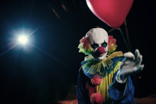 Image Of Clown With Red Balloo...