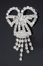 A Brooch As Bow With Diamond Stones On Black