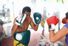 Mature Woman Practicing Boxing...