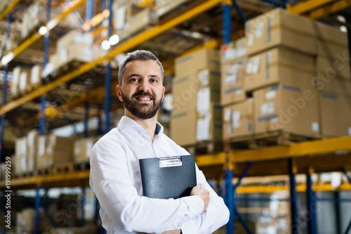Portrait of a male warehouse worker or supervisor. Fototapeta