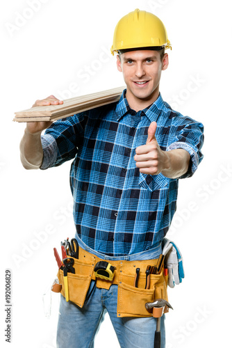 Happy carpenter with a hard wood floor panel