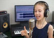 Little Girl Singing A Song In ...