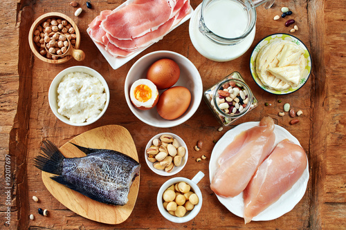 Flat Lay Of High Protein Foods On Rustic Wooden Table Milk Eggs