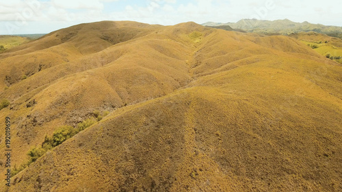 Staande foto Heuvel Aerial view Beautiful hilly mountains landscape. Big hills on a tropical island Bohol , Philippines. Travel concept.