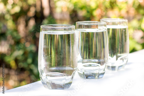 In de dag Apotheek row of ice water glass with blur green background