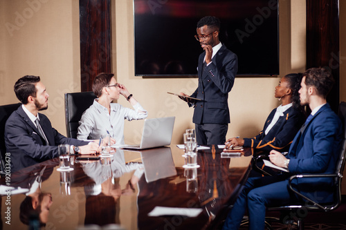 African American Business Man Giving A Presentation To