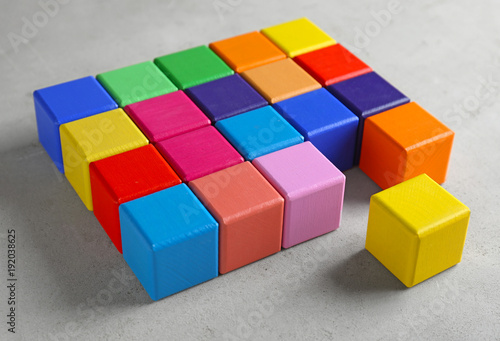 Color cubes on light background  Unity concept - Buy this stock