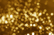 Abstract Gold Bokeh Blur Background.