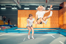 Two Sisters Bouncing In The Tr...