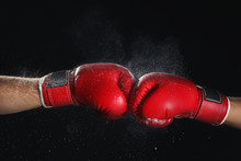 Men In Boxing Gloves On Black Background