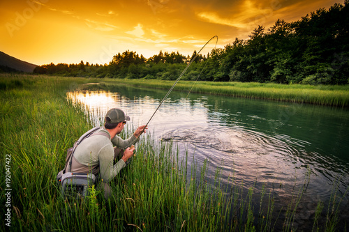 Tuinposter Vissen Fly fisherman fishing pike in river