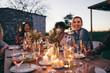 Leinwandbild Motiv Millennials enjoying dinner in outdoor restaurant
