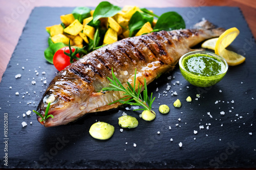 Foto op Canvas Vis Grilled trout with potato and spinach