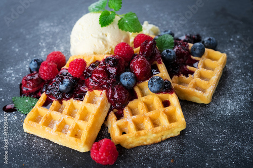 Papiers peints Dessert Waffles with ice cream and hot fruits sauce