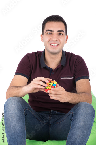 Photographie  smiling guy holding Rubik's cube