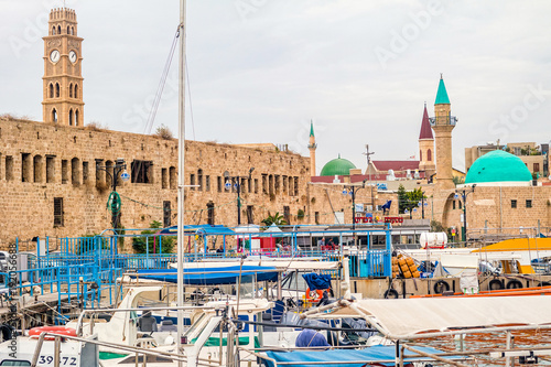 Photo View on marina with yachts and ancient walls of harbor in Acre.