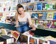 canvas print picture - Woman buying textbooks