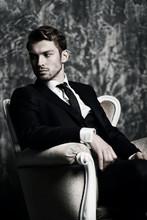Elegant Man In Armchair