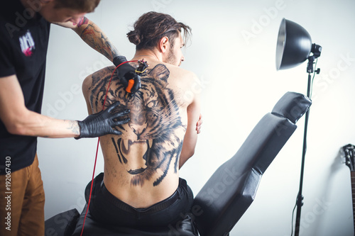 Two men in a tattoo parlor Canvas Print