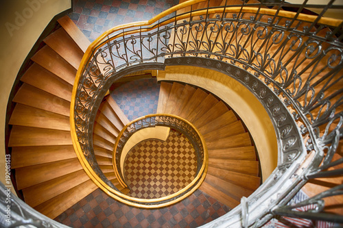 Wall Murals Spiral staircase in the old house in Warsaw