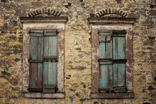 Close Up View Of Old, Rusty, Closed Wooden Shutters And Stone Wa