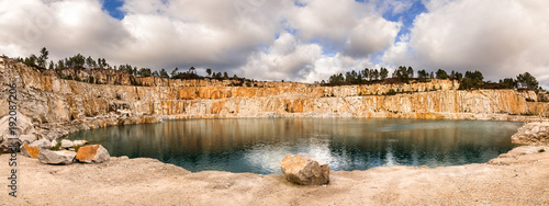 Fényképezés  Blue lake in mining industrial crater, acid mine drainage in rock,Spain