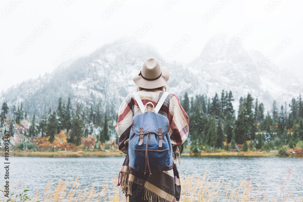 Fototapety, obrazy: Styish woman feeling happy among amazing mountains, enjoy the nature landsape. Forest and lake, wearing backpack, hat and poncho, boho and wanderlust style