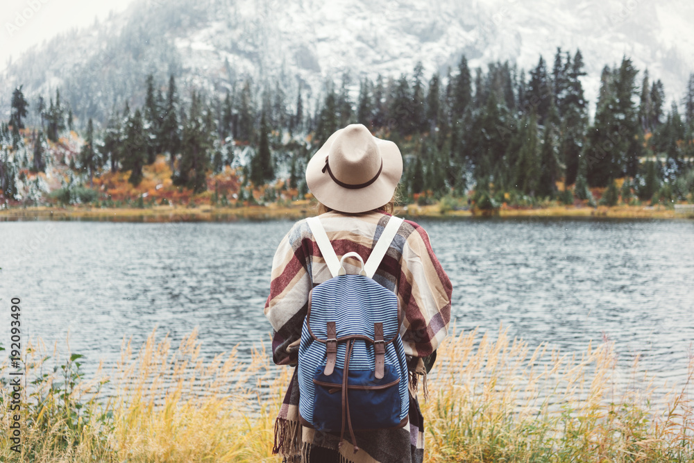 Fototapety, obrazy: Adventure woman feeling happy among amazing mountains, enjoy the nature landsape. Forest and lake, wearing backpack, hat and poncho, boho and wanderlust style