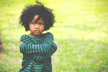 Portrait Of Little Boy Feeling Sad And Boring Face