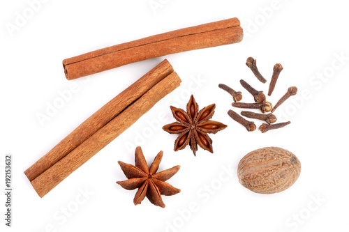 Foto Cinnamon sticks with star anise, nutmeg and clove isolated on white background