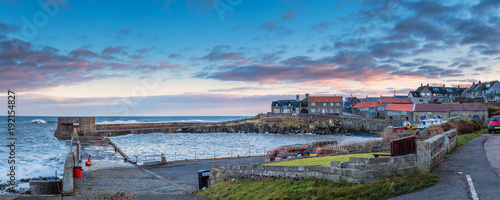 Recess Fitting Northern Europe Craster Harbour and Village Panorama / Craster is a small fishing village on the Northumberland coast, with a small harbour and views to the ruins of Dunstanburgh Castle