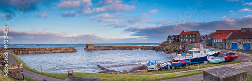 Wall Murals Northern Europe Panorama of Craster Harbour / Craster is a small fishing village on the Northumberland coast, with a small harbour and views to the ruins of Dunstanburgh Castle
